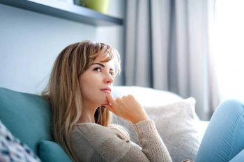woman-at-home-deep-in-thoughts-thinking-and-planni-LXH6YHM-scaled.jpg